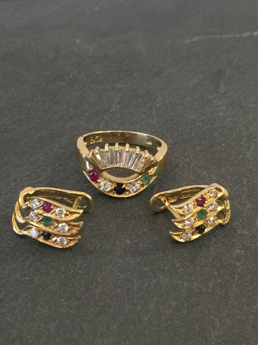 Gold ring and gold earrings
