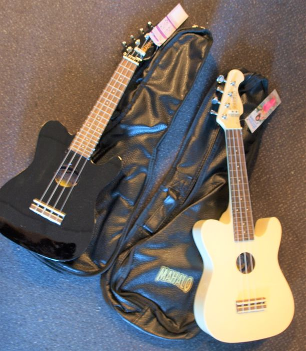 2 new Soprano ukuleles with bag, black and white telecaster model