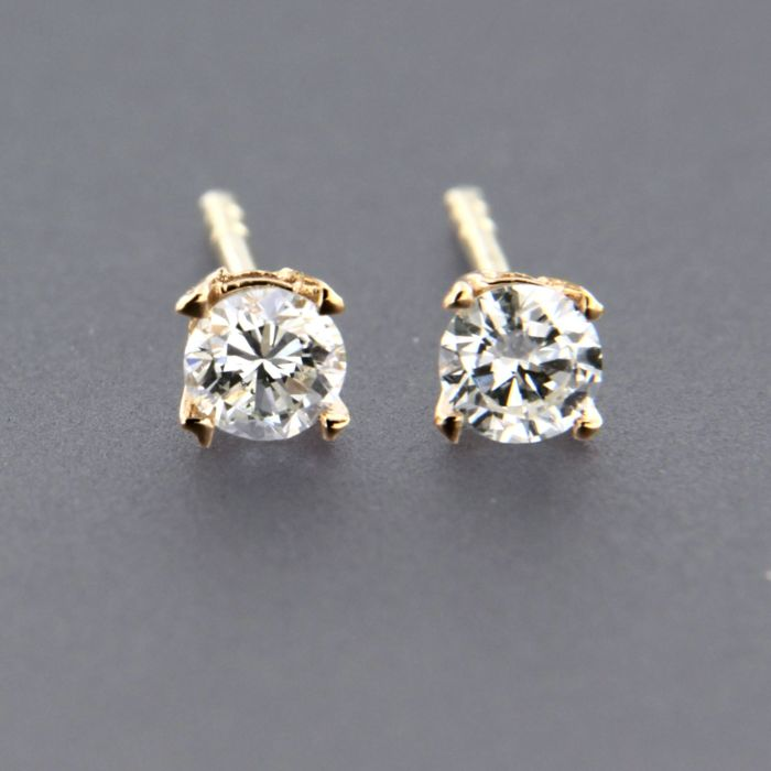 14 kt rose gold solitaire ear studs set with brilliant cut diamond approx.  0.32 carat 988b4164292a6