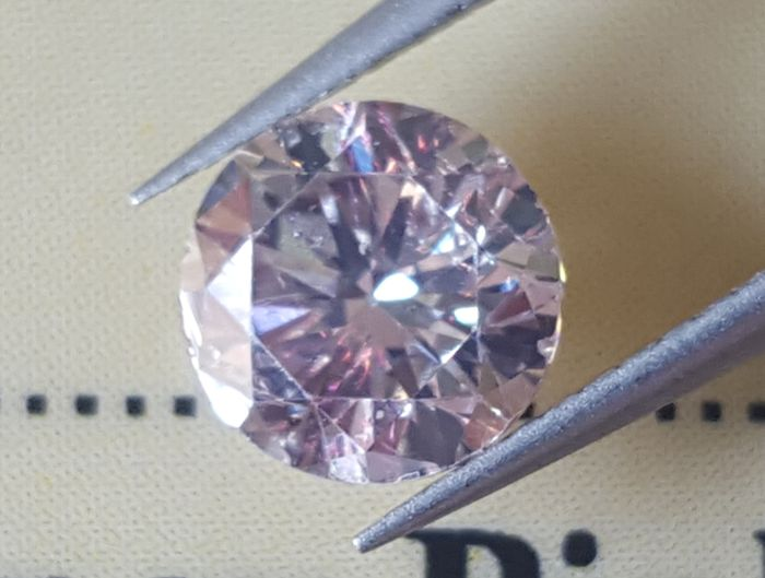 0.69 ct, SI1, round brilliant diamond N. F. Pink brown, only clarity enhanced, European Seller