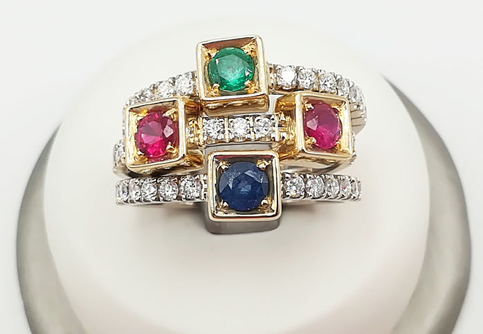 Set of three rings in 18 kt white and yellow gold with 0.78 ct brilliant cut diamonds, 0.30 ct emerald, 0.60 ct rubies and 0.30 ct sapphire. Size 19
