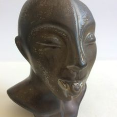 Maker unknown - money bank in the shape of a stylised head