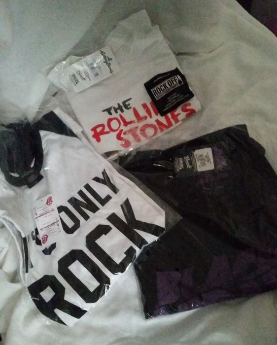 Three great T shirts; Two Rolling Stones T shirts and one Black Sabbath, mint in original bags. All are size XL.