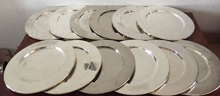 12 silver plated under plates with raised edge, late 20 th century.