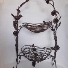 A very nice etagere made of forged and browned iron in the hape of bird nests