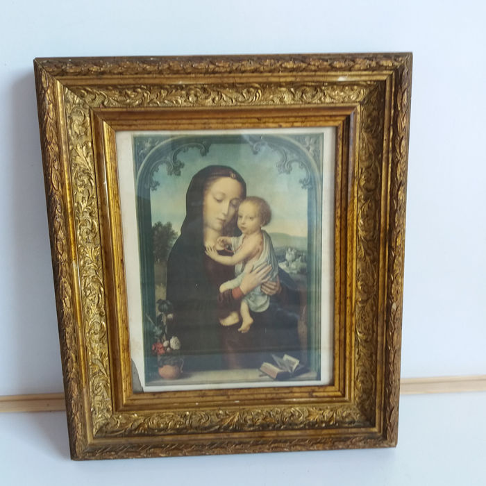 Very old print of Mary and child in a beautifully decorated frame, Spain, early 20th century