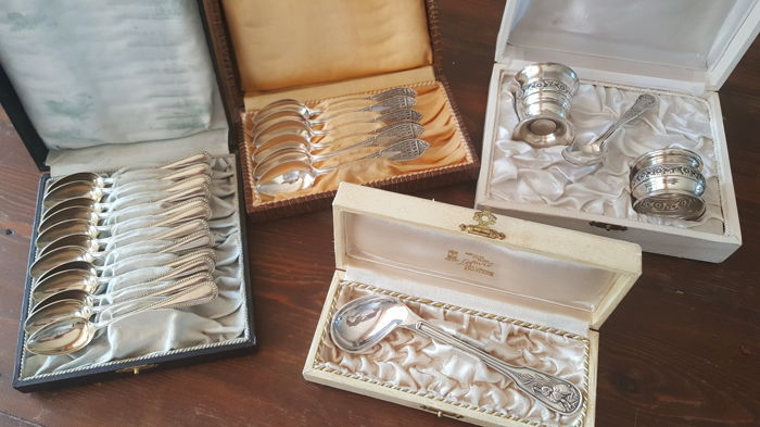 Several gift boxes (birth) with silver plated spoons and other.