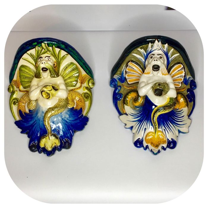 Ulisse Cantagalli (1839/1901) a pair of  ceramic wall brackets, decorated with mithological marine characters