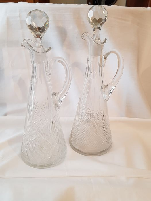 A set of cut crystal handle decanters - the Netherlands - circa 1900