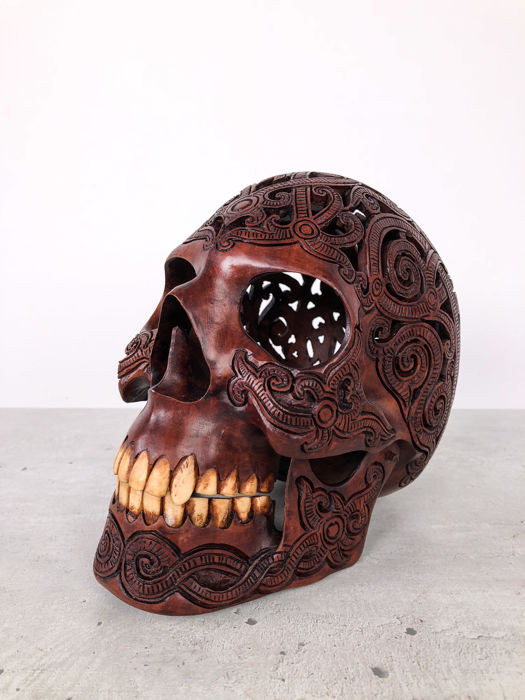 Hand carved Human skull - Tribal style carving - Traditional Dayak carving, Indonesia - Teeth made from buffalo bone