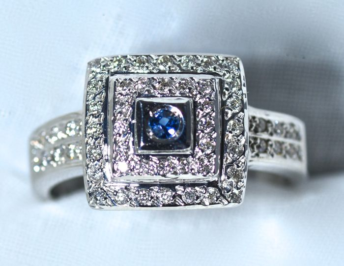 Heavy white gold ring of 18 kt inlaid in an artisan way with 56 diamonds G-SI 0.42 ct  and 1 blue sapphire colour AA No. 17