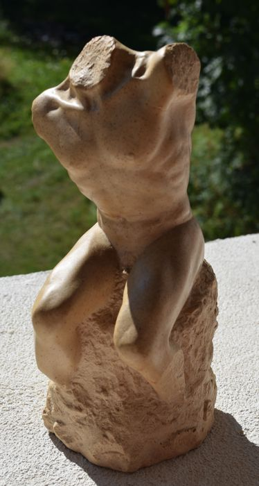 Magnificent stone Sculpture of a male nude on a rock pedestal