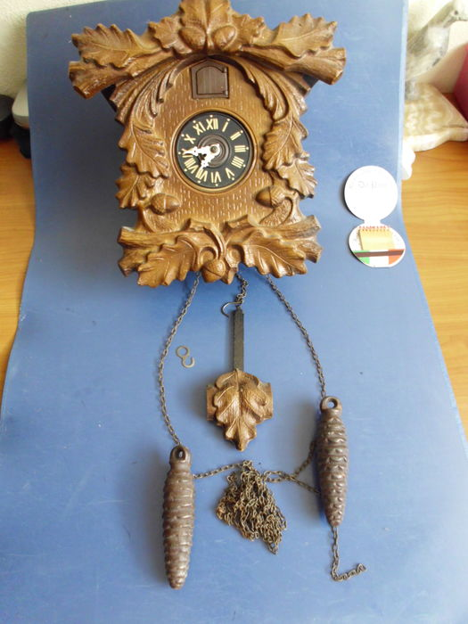 Two black forest cuckoo clocks.