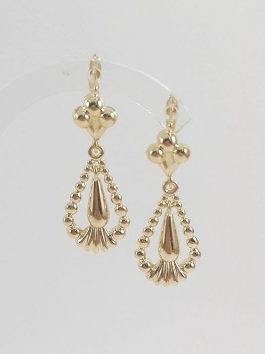 Ladies' pendant earrings in 18 kt yellow gold. Weight 5.2 g
