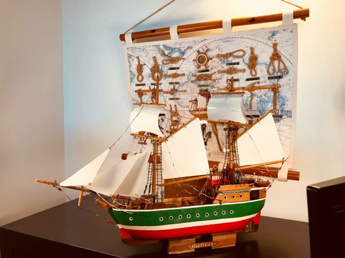 """Large model sailing ship """"Nautilus"""" and a nautical knot overview"""