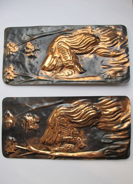 Two copper bas-reliefs depicting hunting dog with bird in the mouth