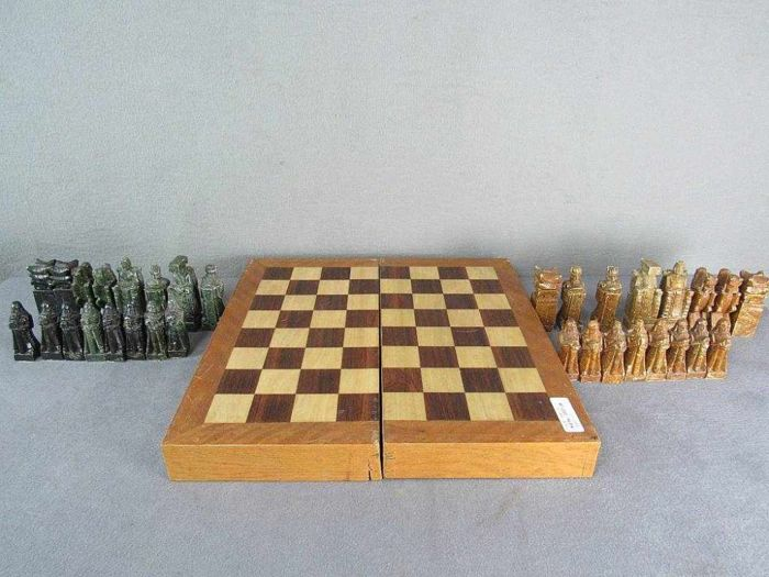 Chess game with hand-carved figures made of semi-precious stones