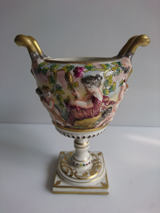 Capodimonte Small Vase With Handles Decors Of Putti And Heads Of