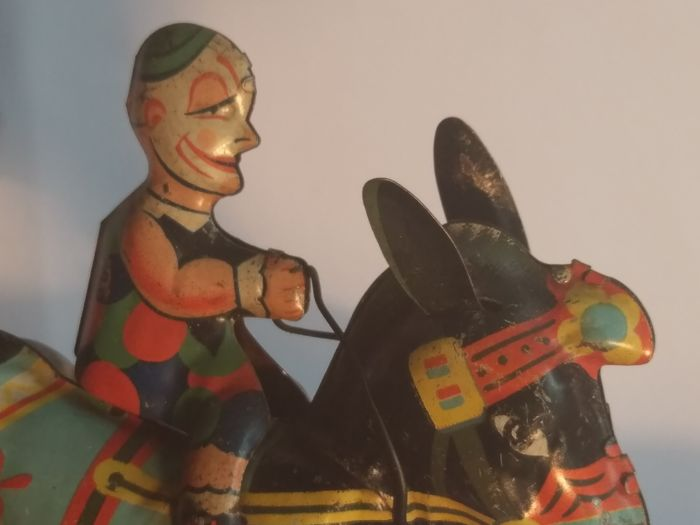 Vintage GAMA Germany Tin Wind up Clown Riding a Rocking Donkey