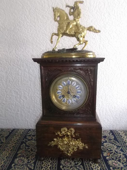 French oak mantel clock inlaid with bronze horseman and Cartouches. Unique