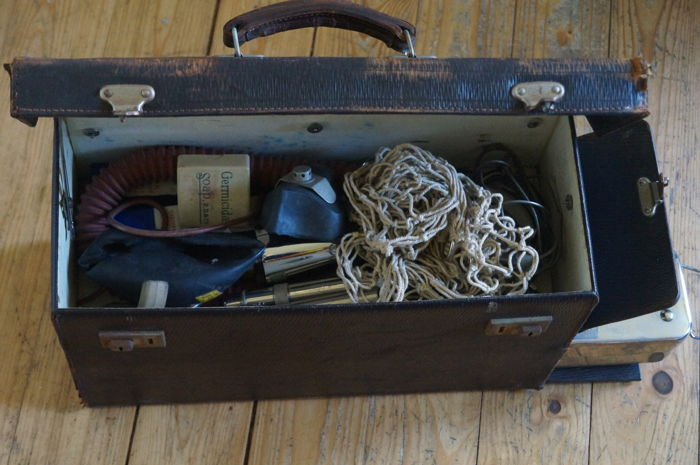 Early XX century black leather medical bag with medical tools