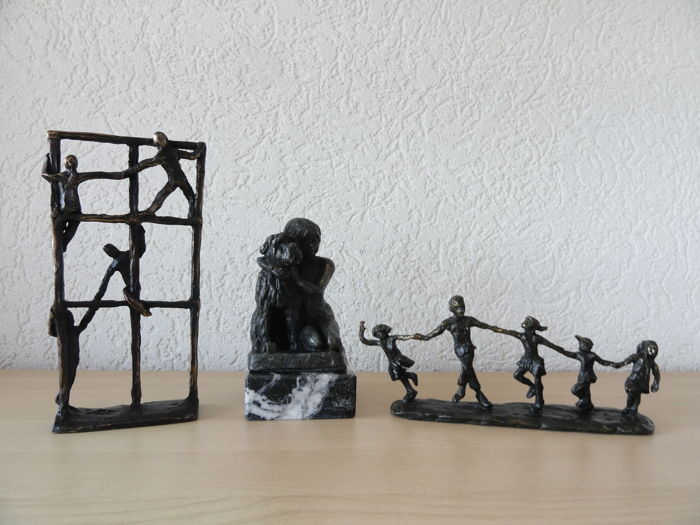 Astrid Veldhuyzen-Koppen - 3 signed, bronze-plated metal sculptures with monogram: Climbing Frame • Girl with Dog • Playing Family