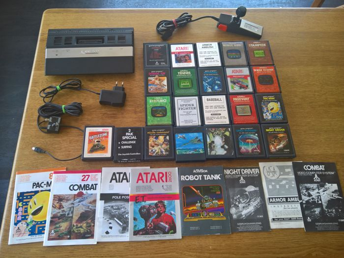 Atari 2600 with 22 games like Pole position , E.T. , Enduro , etc
