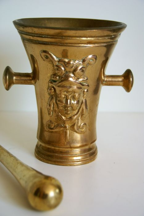 Beautiful heavy bronze mortar 5,2 kg  with two putti/angel face on the both sides.
