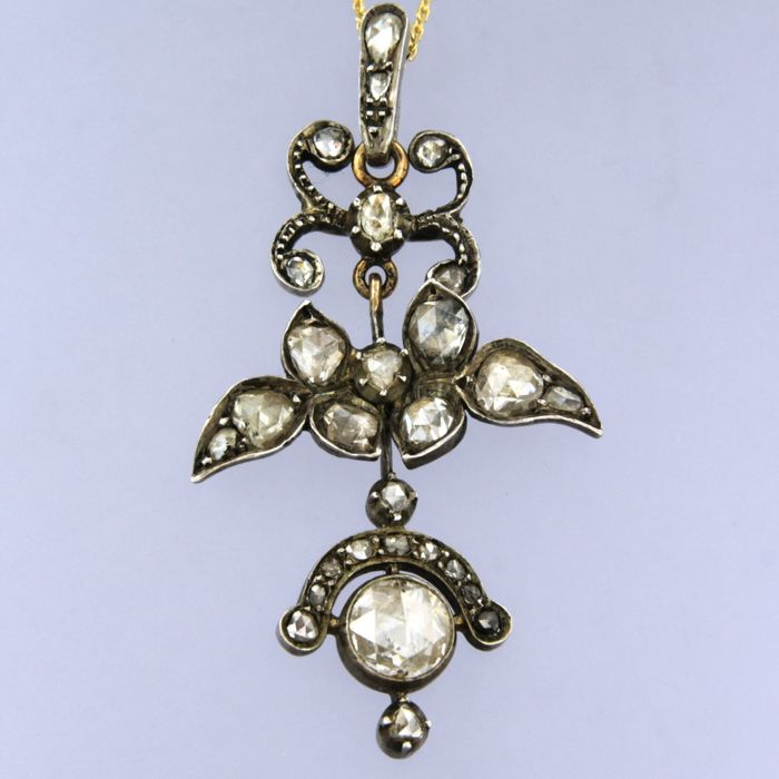 Gold and silver pendant set with 27 rose cut diamonds, approx. 1.70 carat in total, with necklace