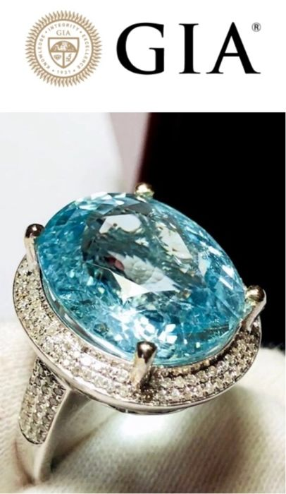 Women's cocktail ring in 18 kt white gold with Paraiba tourmaline for 16.66 ct, GIA certified, and 1.10 ct diamonds