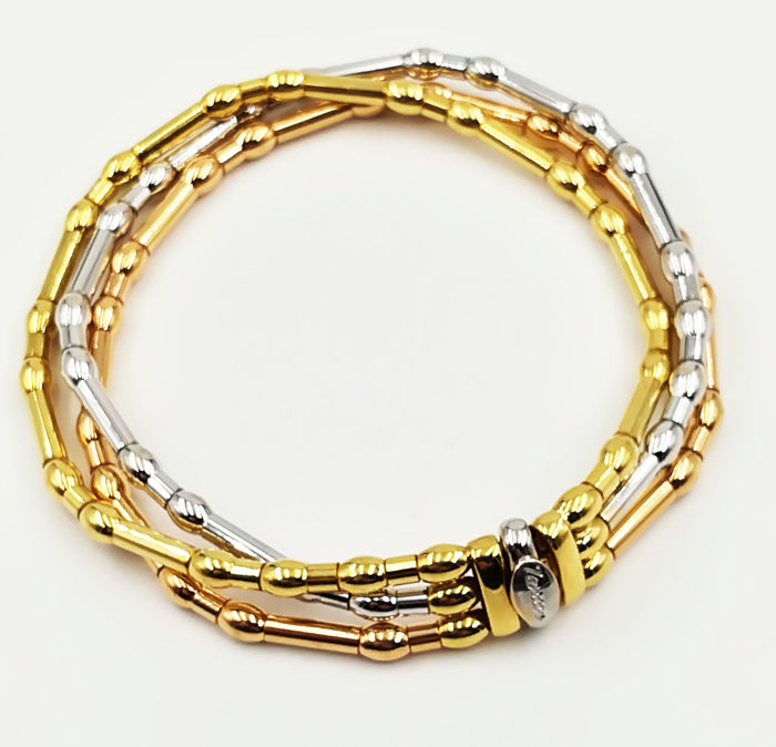 Women's bracelet in 18 kt white, yellow and rose gold, brand: 'ZANCAR', with semi-rigid links, diameter: 8 cm, total weight: 37.09 g