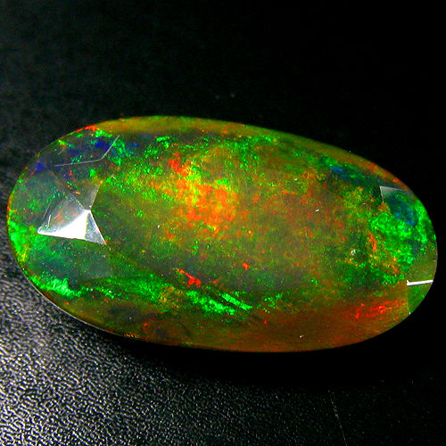 Opal - Dark Brown,  Play of Colors - 10.86 ct - No Reserve