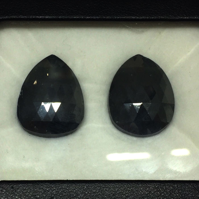 Matching Pair of Treated Black Diamond 61.09 ct. Pear shape Flat one side Diamond, AIG Certified
