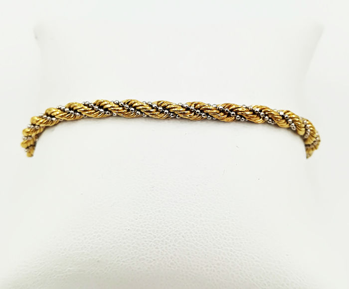 Bracelet in 18 kt yellow and white gold with spiral links, length 19.50 cm, total weight  5.54 g