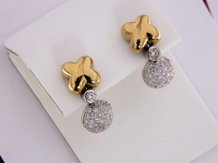 Earrings, 2 types of 18 kt gold, with diamonds.