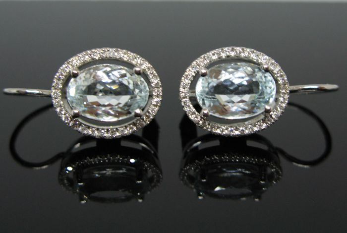 """ Lady D "" model 18 kt white gold big earrings set with 2 natural aquamarine oval faceted-cut ct 7,60 tot and 60 diamonds round-brillant-faceted ct 0,60 tot F-VVS1. No reserve price."