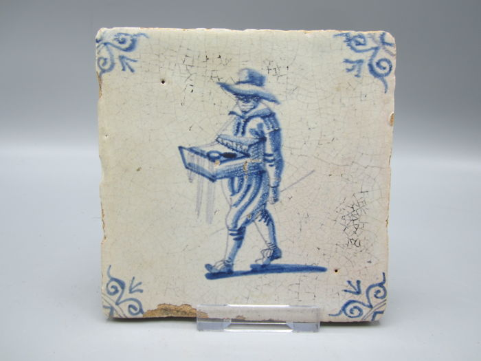Tile with painting on the reverse