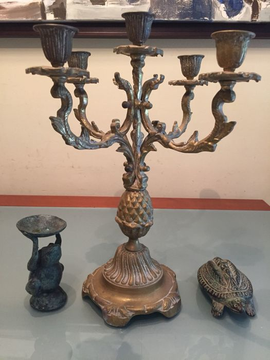 Sculptures of African ethnic art and bronze candlestick