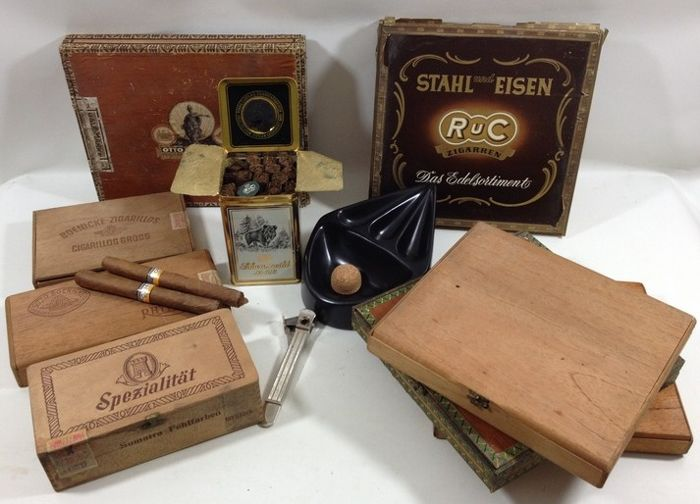 An old set of tobacco accessories, cigars