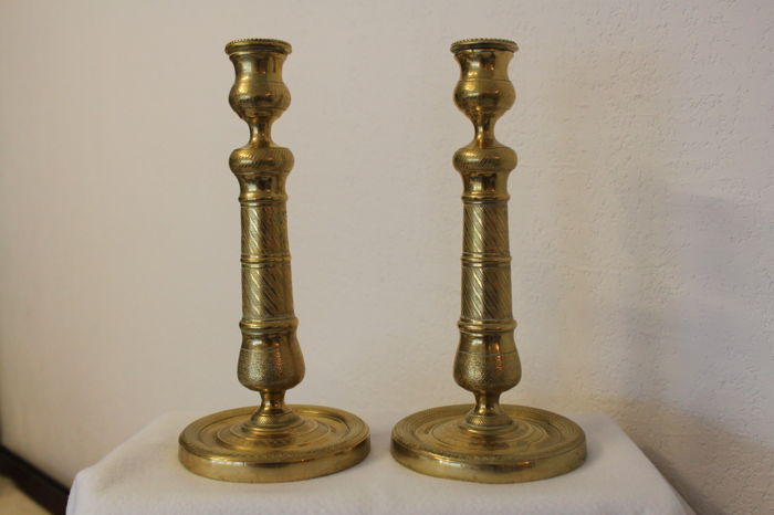Pair of embossed bronze candleholders - France - 19th century