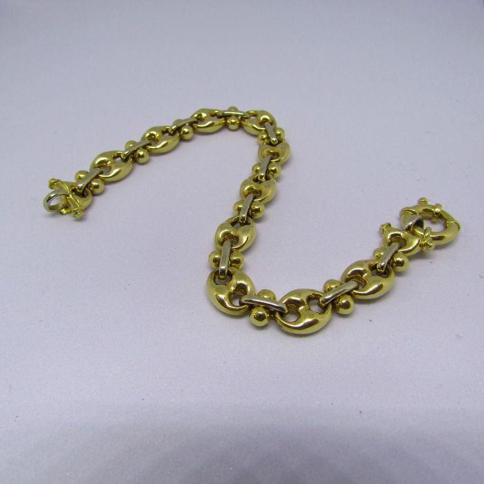 Articulated bracelet in 18 kt two-tone Gold. Hawser type links. Weight: 19 g