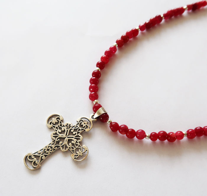Necklace made of ruby and silver beads, adorned with a large sterling silver cross