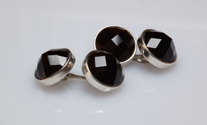 White gold cufflinks with faceted black onyx