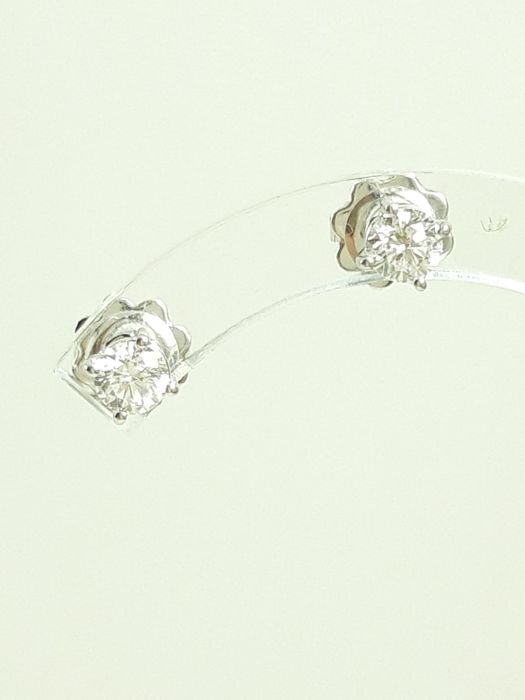 Women's solitaire earrings in 18 kt white gold and natural diamonds 0.60 ct total Weight 1.6 g