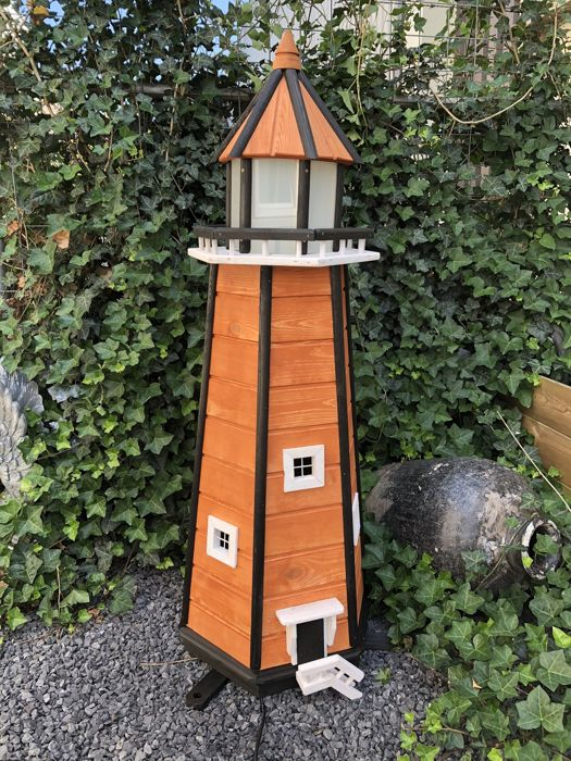 Handmade and wonderfully designed wooden lighthouse with a light - 21st century