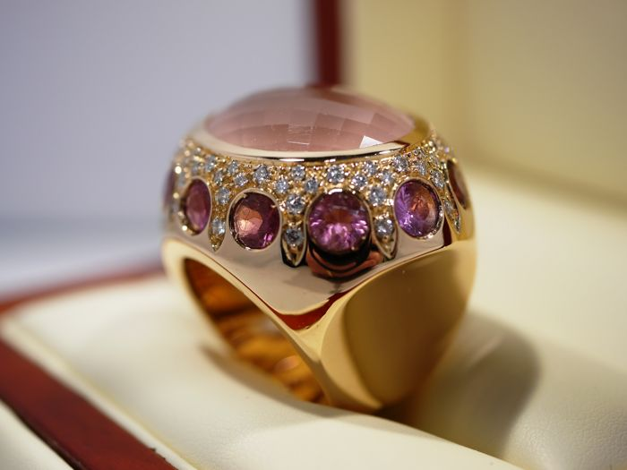 Ring rose gold 750 rose quartz 25.00 ct and 74 diamonds 1.00 ct and 12 pink sapphires of 5.00 ct