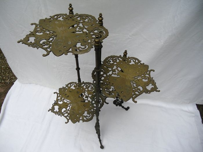 Large beautifully designed brass table side table columns table with butterfly motif