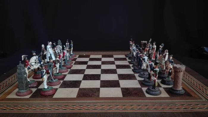 Napoleonic Wars Chess Game - c.a. 1950  - United Kingdom Versus First French Empire - Lead Pieces In Metal base - Wooden  Chess Board included.