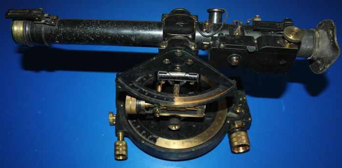 An E.R. Watts & Son Director /Theolite 1916 dated Brass artillery gun sight, marked with broad arrow ,in solid mahogany case  optics in good  condition