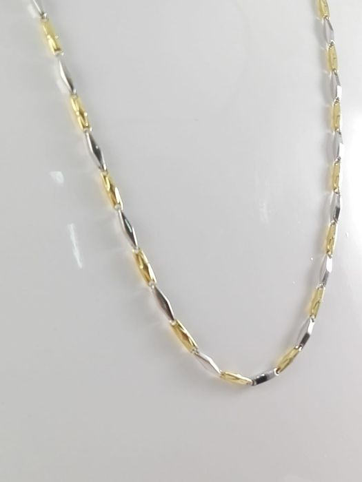 """Fulkro"" men's necklace with fantasy links in 18 kt white and yellow gold Weight: 9.0 g"